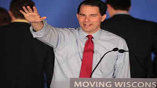 Wisconsin Governor Scott Walker greets supporters at an election-night rally June 5, 2012 in Waukesha, Wisconsin.