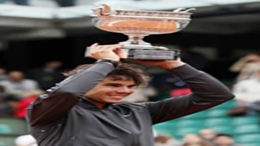 Rafael Nadal celebrates with his trophy after winning the French Open tennis tournament at the Roland Garros stadium, on June 11, 2012 in Paris.