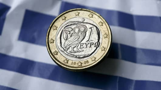 Greec flag and euro coin