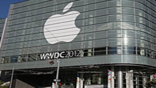 Attendees line up to enter the Apple World Wide Developers Conference (WWDC) at Moscone West in San Francisco, California.