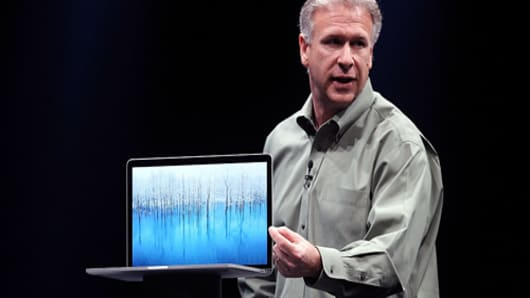 Apple Senior Vice President of Worldwide product marketing Phil Schiller announces the new MacBook Pro during the keynote address during the Apple 2012 World Wide Developers Conference (WWDC).