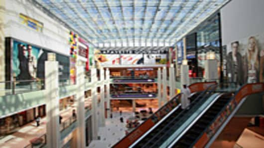 Stores are seen surrounding an atrium inside the Dubai Mall.