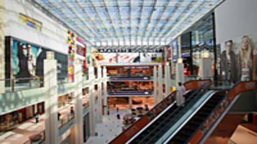 Stores are seen surrounding an atrium inside the Dubai Mall.