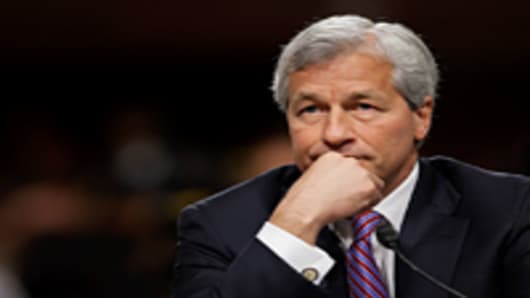 Dimon said the bank will probably seek to claw back pay from executives responsible for $2 billion in trading losses.