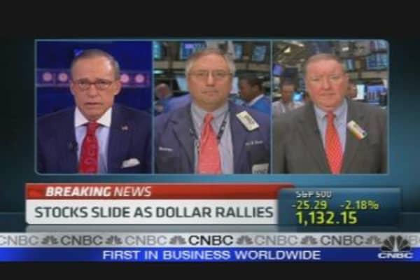 Stocks Slide as Dollar Rallies