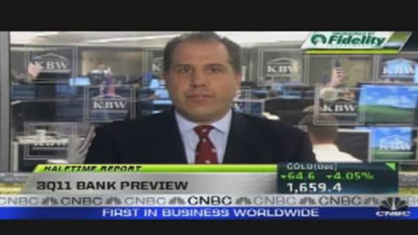 Financials Roar Back, Despite Profit Worries