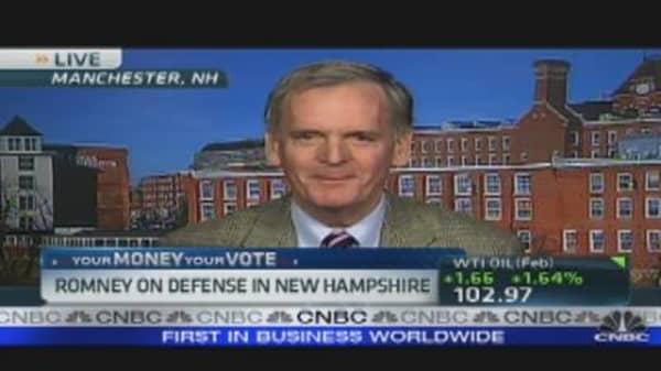 Romney Defends Business Background