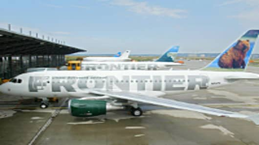 An Airbus A318 with the logo of US company Frontier Airlines is seen on the tarmac of Hamburg Finkernwerder airport.