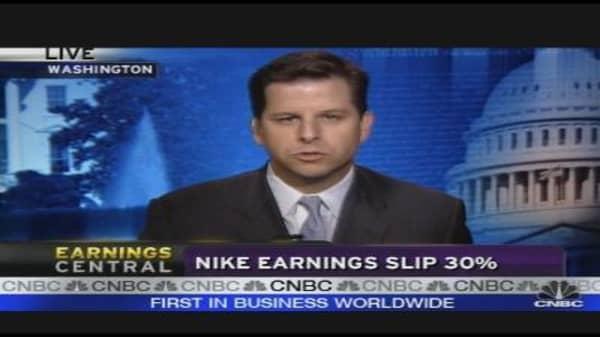 Nike Earnings Slip 30%