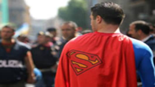 09 Jun 2007: Rome, ITALY: A man dressed as Superman protests in front of policemen during a demonstration against US President George W. Bush planned by pacifist movements, anti-globalisation and far-left parties in Rome, 09 June 2007. US President George W. Bush is greeted by two separate demonstrations in Rome as the far left of Italy's ruling centre-left coalition seeks to distance itself from more hardline anti-US campaigners.