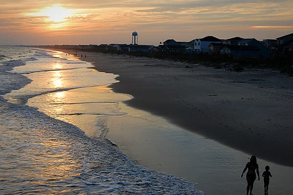 Average household income: $60,210Oak Island is both the name of a barrier island located on the southern end of North Carolina's coast, and the town located on the island and on the coast. It's the largest coastal community in the state. Oak Island attracts many nature lovers, with its sprawling live oaks, 50 lakes for fishing, swimming and boating, easy access to the Intracoastal Waterway, and the nature preserves including loggerhead sea turtles, which lay their eggs on the beaches.
