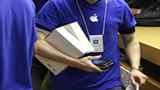 An Apple employee carrying new iPad tablets.