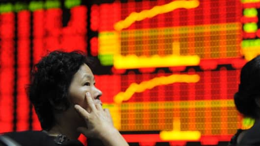 chinese stocks investor positive.jpg