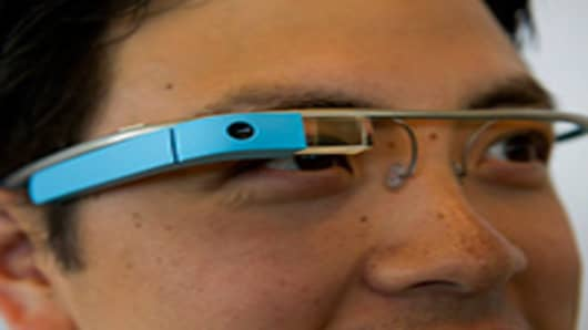 Google Inc employee Ray Liu, wears Project Glass internet glasses during a demonstration during at the Google I/O conference in San Francisco, California.
