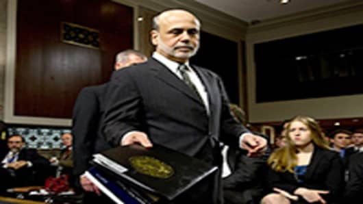U.S. Federal Reserve Board Chairman Ben Bernanke arrives to testify at the Senate Banking, Housing and Urban Affairs Committee on Capitol Hill.