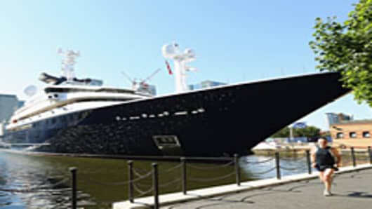 The 414ft luxury yacht 'Octopus' owned by Microsoft co-founder, Paul Allen, is moored in South Quay on the Isle of Dogs on July 23, 2012 in London, England.
