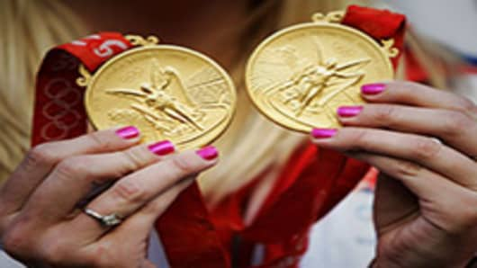 British Double Olympic Gold Medalist Rebecca Adlington shows her medals from the 2008 Summer Olympics held in Beijing, China.