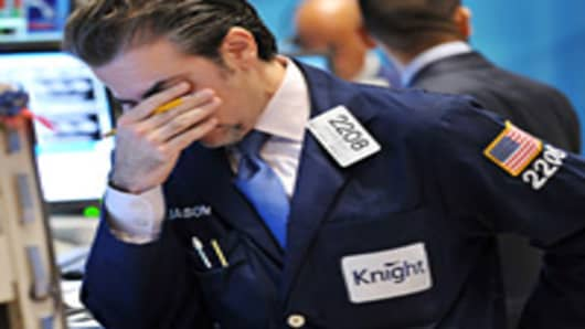Jason Blatt of Knight Captial, Americas, LP reacts to down markets on the New York Stock Exhchange floor.