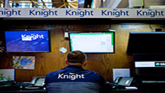 A trader works at a Knight Capital Group Inc. post on the floor of the New York Stock Exchange.