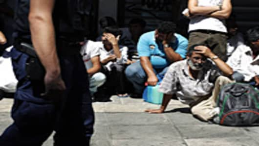 Police detain a group of immigrants in central Athens on August 5,2012. Greek police authorities launched a large scale operation in central Athens in an effort to control illegal immigration in the Greek capital, more than four thousand immigrants have been detained so far.