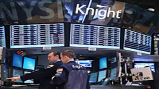 Traders work on the floor of the New York Stock Exchange during morning trading on August 6, 2012 in New York City. Knight Capital has reached a deal with a group of investors for $400 million after the trading firm suffered a massive loss from a computer trading glitch last week.