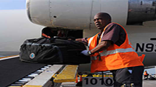 luggage-loaded-onto-plane-200.jpg