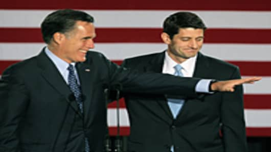 Republican presidential candidate, former Massachusetts Governor Mitt Romney (L) is introduced by Wisconsin Congressman Paul Ryan at an election-night rally April 3, 2012 in Milwaukee, Wisconsin.