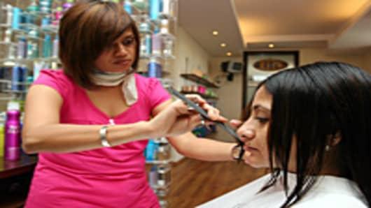 Shonali Datta, getting her hair cut by an international hairstylist at Juice Hair Salon in Mumbai, Maharashtra, India.