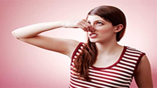 girl-holding-nose-200.jpg