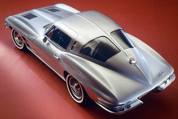 """The 1963 Chevrolet Corvette is distinguished as the first year of second-generation (or """"mid-year"""") Corvette; only year with """"split window"""" rear glass. It was also the first Corvette with hidden headlamps and independent rear suspension. Modern Day Successor:"""