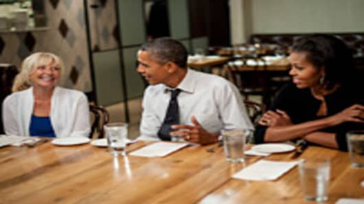 President Barack Obama and first lady Michelle Obama have dinner with three winners of 'Dinner with Barack and Michelle' fundraising contest on August 20, 2012 at Mintwood Place in Washington, DC.