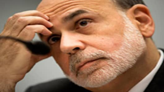 Ben S. Bernanke, chairman of the U.S. Federal Reserve, waits to deliver his semiannual monetary policy report to the House Financial Services Committee in Washington, D.C., U.S., on Wednesday, July 18, 2012.