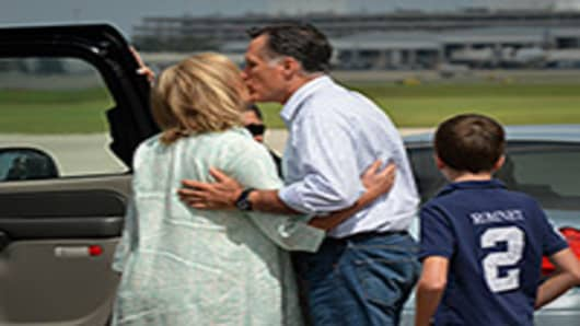US Republican presidential candidate Mitt Romney kisses his wife Ann upon arriving in Tampa, Florida.