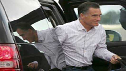 Republican presidential candidate, former Massachusetts Gov. Mitt Romney exits a vehicle before boarding his campaign plane on August 29, 2012 in Tampa, Florida. As the Republican National Convention continues, Romney will travel to Indianapolis to address the American Legion.