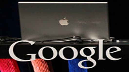 An Apple laptop sits in a podium with the Google logo during a Google special event on September 8, 2010 in San Francisco, California.