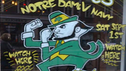 A pub sign in Dublin advertising the Notre Dame vs. Navy college football game.