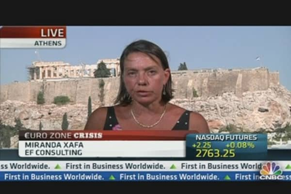 Greece Needs Debt Relief, Not Time or Money