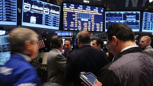 Traders work on the floor of the New York Stock Exchange on December 10, 2012 in New York City.