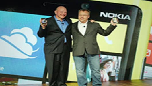 Nokia Chief Executive Stephen Elop stands with Steve Ballmer, Chief Executive Officer of Microsoft, during the introduction of the new Nokia Lumia 920 and 820 Windows smartphones.