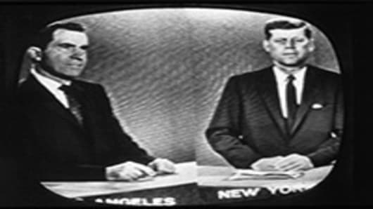 Presidential candidates Richard Nixon and John F. Kennedy during a televised debate.