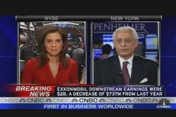 Exxon Mobil Profit Falls