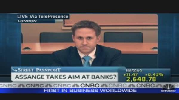 Assange Aims at Banks