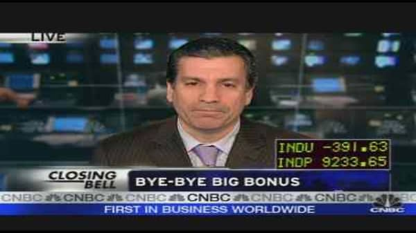 Goldman Cuts Jobs & Bonuses