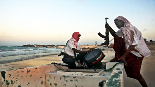 Armed Somali pirates carrying out preparations to a skiff in Hobyo, northeastern Somalia, ahead of new attacks on ships sailing in the Gulf of Aden.