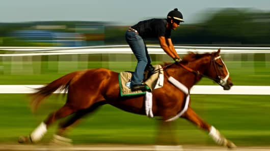 Exercise rider Jonny Garcia takes Triple Crown hopefull I'll Have Another over the track in preparation for the 144th Belmont Stakes at Belmont Park on June 7, 2012 in Elmont, New York.