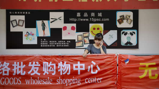 Student in front of an online Taobao shop.