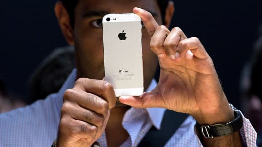 An attendee views the new Apple Inc. iPhone 5 during an event in San Francisco, California, U.S., on Wednesday, Sept. 12, 2012.