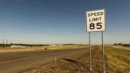 An 85 mph speed limit sign is placed on the 41-mile-long toll road in Austin.