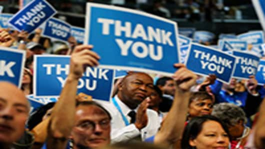 Attendees hold signs that say 'Thank You' for miltary veterans during the final day of the Democratic National Convention.