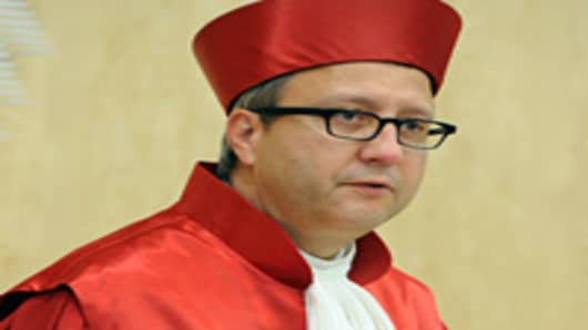 Andreas Vosskuhle, chairman of the Second Senate at the Federal Constitutional Court in Karlsruhe, southern Germany, proclaims the senate's judgement on the say of the German parliament in negotiations on the EU's permanent bailout fund (ESM), on June 19, 2012.